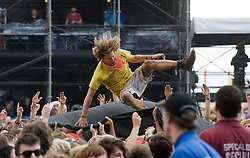 © Licensed to London News Pictures. 27/08/2011. Reading, UK. Crowds enjoying Madness on  Day two of Reading Festival 2011 in Reading, Berkshire today (27/08/2011). Photo credit: Ben Cawthra/LNP