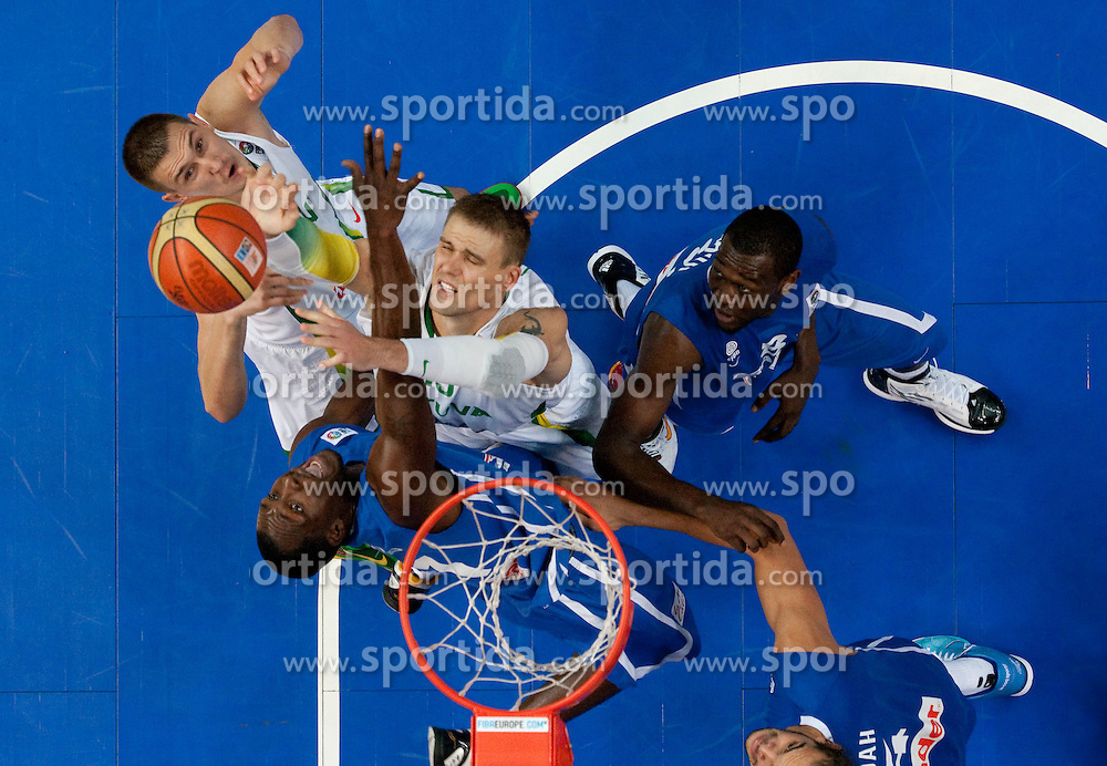 Florent Pietrus of France vs Robertas Javtokas of Lithuania during basketball game between National basketball teams of Lithuania and France at FIBA Europe Eurobasket Lithuania 2011, on September 9, 2011, in Siemens Arena,  Vilnius, Lithuania. France defeated Lithuania 73-67.  (Photo by Vid Ponikvar / Sportida)