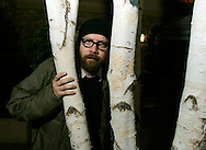 """Cast member Paul Giamatti poses in a stand of trees at the 25th annual Sundance film festival in Park City, Utah January 23, 2006. Giamatti appears in """"The Illusionist"""" showing at Sundance. The film takes place in turn-of-the-century Vienna, where a magician uses his abilities to secure the love of a woman far above his social standing. REUTERS/Rick Wilking"""
