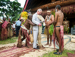File photo dated 08/04/18 of the Prince of Wales being given a grass skirt to wear prior to receiving a chiefly title during a visit to the Chiefs' Nakamal, as he visits the South Pacific island of Vanuatu. A remote tribe in the island nation who revered Prince Philip as a god-like figure will mark his death with dancing, speeches and the ceremonial drinking of the native plant kava, according to an expert on the culture. Issue date: Friday April 16, 2021.