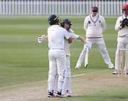 Bayley Wiggins of CD celebrates his 100 with a hug from Ben Wheeler. Canterbury vs. Central Districts Day 1, 1st round of the 2021-2022 Plunket Shield cricket competition at Hagley Oval, Christchurch, on Saturday 23rd October 2021.<br /> © Copyright Photo: Martin Hunter/ www.photosport.nz