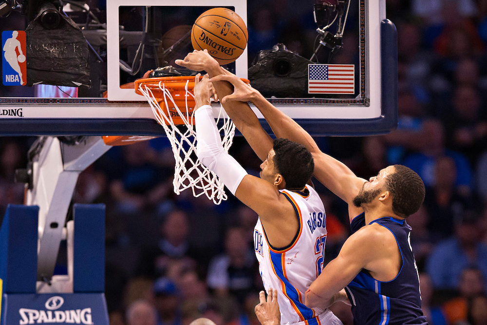 OKLAHOMA CITY, OK - JANUARY 13:  Andre Roberson #21 of the Oklahoma City Thunder is fouled from behind by JaVale McGee #11 of the Dallas Mavericks at Chesapeake Energy Arena on January 13, 2016 in Oklahoma City, Oklahoma.  NOTE TO USER: User expressly acknowledges and agrees that, by downloading and or using this photograph, User is consenting to the terms and conditions of the Getty Images License Agreement.   (Photo by Wesley Hitt/Getty Images) *** Local Caption *** Andre Roberson; JaVale McGee