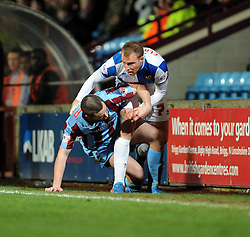 Bristol Rovers' David Clarkson tangles with Scunthorpe United's Eddie Nolan - Photo mandatory by-line: Dougie Allward/JMP - Tel: Mobile: 07966 386802 25/02/2014 - SPORT - FOOTBALL - Scunthorpe - Glanford Park - Scunthorpe United v Bristol Rovers - Sky Bet League Two