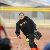 032015  Adron Gardner/Independent<br /> <br /> Gallup JV Bengal Tyra Jeff  pitches to a Hatch Valley Bear during the Grants Invitational Softball tournament in Grants Friday.