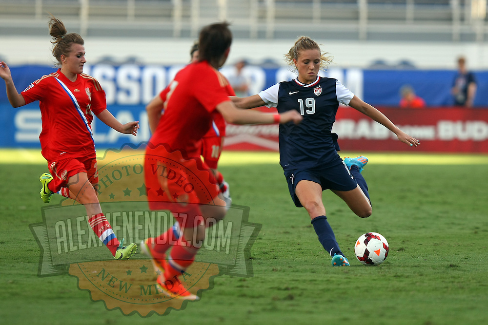 U.S. defender Kristie Mewis (19) kicks the ball during an international friendly soccer match between the United States Women's National soccer team and the Russia National soccer team at FAU Stadium on Saturday, February 8, in Boca Raton, Florida. The U.S. won the match by a score of 7-0. (AP Photo/Alex Menendez)