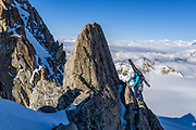 Jasmin Caton climbing the exposed ridge of Aguille du Tour, while on a backcountry ski tour from the Trient Hut, Swiss/French border, alps.     //an outing close-ish to the first hut on the Haute route if oure starting in Chamonix - this is a classic summit outing - exposed 5th class ridge scrambling, really fun, and excellent granite. You can actually see the hut in the background behind Jas, and our ski tracks from the hut down into the glacier. Jasmin and I had been shut down by weather, but mostly by poor freezes, and I had extended my stay so that we at least could try to get a few good days out - and this evening was easily the best of the trip  - classic Alps summit on the classic hut route.