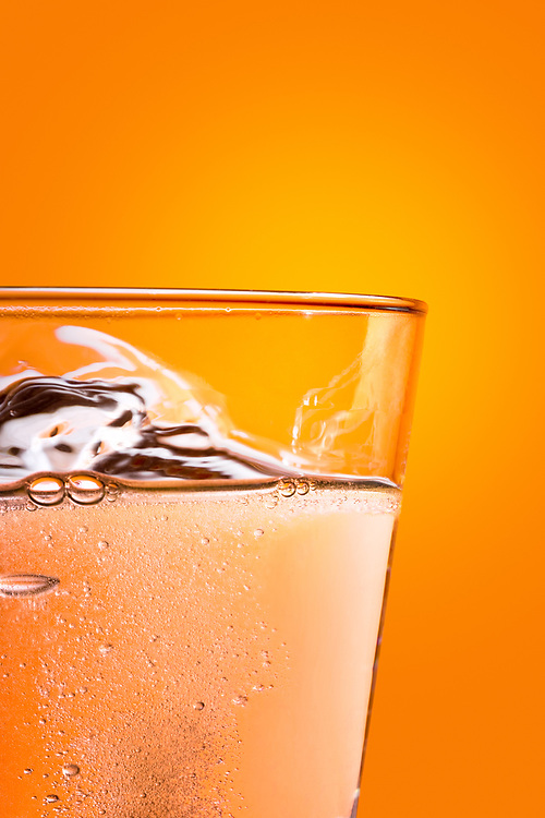 Effervescence tablet dissolving on a glass of water