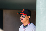 Manny Machado #13 of the Baltimore Orioles looks on from the dugout before a game against the Minnesota Twins on May 12, 2013 at Target Field in Minneapolis, Minnesota.  The Orioles defeated the Twins 6 to 0.  Photo: Ben Krause