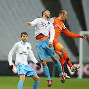 Trabzonspor's Remzi Giray Kacar (C)  during their Turkish soccer superleague match IBBSpor between Trabzonspor at the Ataturk Olympic stadium in Istanbul Turkey on Saturday 07 January 2012. Photo by TURKPIX