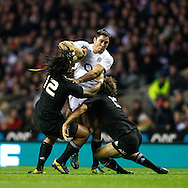 Picture by Andrew Tobin/SLIK images +44 7710 761829. 2nd December 2012. Brad Barritt of England is tackled by Ma'a Nonu (L) and Conrad Smith (R) of New Zealand during the QBE Internationals match between England and the New Zealand All Blacks at Twickenham Stadium, London, England. England won the game 38-21.