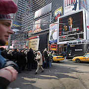 People gather in Times Square in New York City to watch the inauguration of President Barack Obama in Washington DC January 20, 2009.