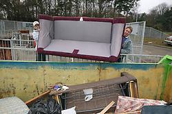 Dumping old sofa at the Tipsmart recycling centre at Calverton,
