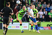 Forest Green Rovers Farrend Rawson(6) beats Tranmere Rovers James Norwood(10) during the EFL Sky Bet League 2 second leg Play Off match between Forest Green Rovers and Tranmere Rovers at the New Lawn, Forest Green, United Kingdom on 13 May 2019.