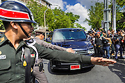 23 MAY 2014 - BANGKOK, THAILAND: Thai police try to clear the way fro a van bringing Thai civilian politicians into a military compound in Bangkok. The politicians were ordered to turn themselves in by the Thai army General Prayuth Ocha-chan. The Thai military seized power in a coup Thursday evening. They suspended the constitution and ended civilian rule. This is the 2nd coup in Thailand since 2006 and at least the 12th since 1932.    PHOTO BY JACK KURTZ