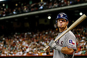June 28, 2011; Houston, TX, USA; Texas Rangers left fielder Josh Hamilton (32) warms up in the on deck circle against the Houston Astros in the fourth inning at Minute Maid Park. Mandatory Credit: Thomas Campbell-US PRESSWIRE