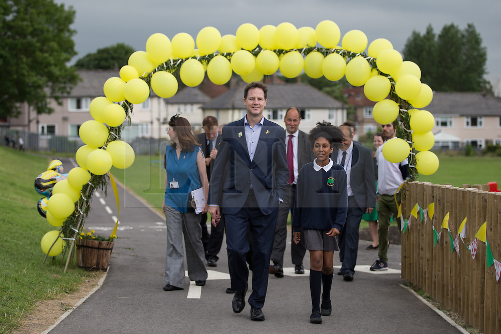 © Licensed to London News Pictures . 03/07/2014 . Leeds , UK . The Deputy Prime Minister , NICK CLEGG MP , at Ireland Wood Primary School in Leeds today (Thursday 3rd July 2014) shown around by pupil Lashay Henry-Welsh (11) from Yeadon in Leeds (right) . The Liberal Democrat leader and MP for Sheffield Hallam watches a Grand Depart school event with children taking part in cycling time trials and singing the the Tour de France anthem . Photo credit : Joel Goodman/LNP