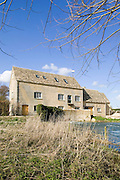 Part of the original Mill dates from c.1575 with a later extension from the mid nineteenth century. It straddles the River Windrush and originally housed two water wheels for processing grain stored in the upper floors. It now houses a neo natal centre: Beard Mill Clinic.