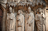 .South Porch, Right Portal c. 1194-1230,  Cathedral of Notre Dame, Chartres, France. Gothic statues of from left to right they are .Statues- Martin, Jerome , Gregory and Avit . A UNESCO World Heritage Site. .<br /> <br /> Visit our MEDIEVAL ART PHOTO COLLECTIONS for more   photos  to download or buy as prints https://funkystock.photoshelter.com/gallery-collection/Medieval-Middle-Ages-Art-Artefacts-Antiquities-Pictures-Images-of/C0000YpKXiAHnG2k