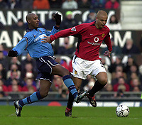 Photo: Greig Cowie<br />Barclaycard Premiership. Manchester United v Manchester City. 09/02/2002<br />Nicolas Anelka trys to stop Wes Brown