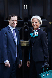 © licensed to London News Pictures. London, UK 04/02/2014. The International Monetary Fund (IMF) Managing Director Christine Lagarde meeting Chancellor of the Exchequer George Osborne outside Number 11 in Downing Street on Tuesday, 04 February 2014. Photo credit: Tolga Akmen/LNP