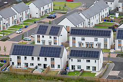 Elevated view of new houses with solar panels on roofs in Raploch district of Stirling , Scotland, UK