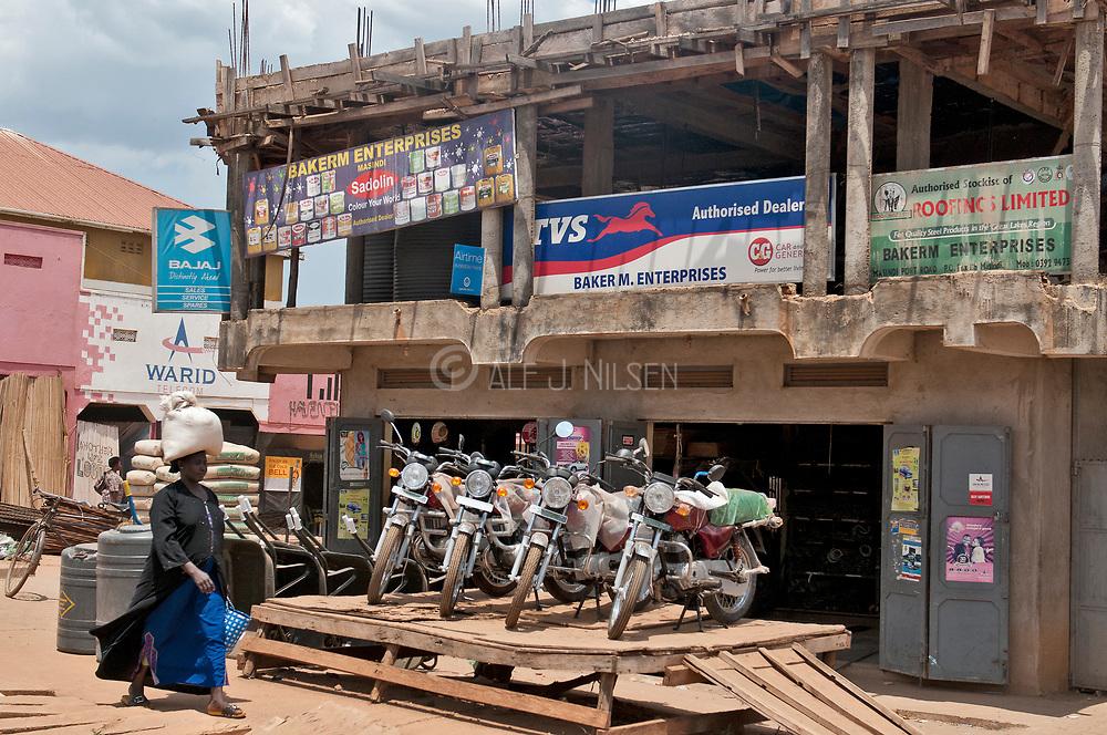 Woman and motorbikes in Masindi, Uganda.