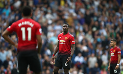 Manchester United's Paul Pogba (centre) appears dejected after Brighton & Hove Albion's second goal of the game