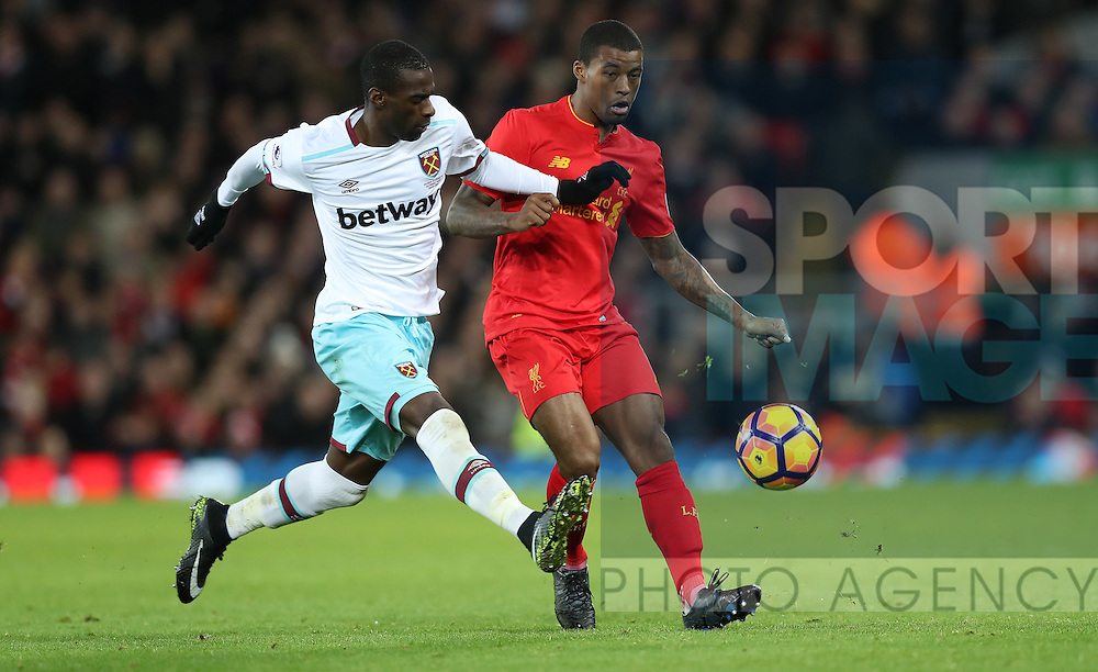 Georginio Wijnaldum of Liverpool and Pedro Obiang of West Ham United during the Premier League match at Anfield Stadium, Liverpool. Picture date: December 11th, 2016.Photo credit should read: Lynne Cameron/Sportimage