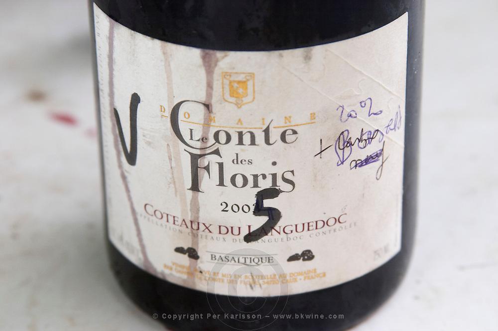 Cuvee Basaltique 2005 in a sampling bottle. Domaine Le Conte des Floris, Caux. Pezenas region. Languedoc. France. Europe. Bottle.