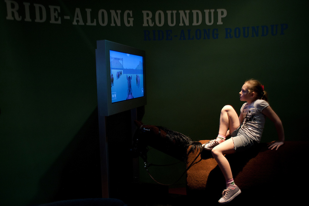 Goodnight Loving Trail...Ft. Worth & Weatherford Destiny Beasley, 9, mounts up for a virtual trail ride at the Cattle Raisers exhibit at the Ft. Worth Museum of Science and History. Facing a mural of the Goodnight-Loving Trail kids of all ages can test their skills at driving a herd.
