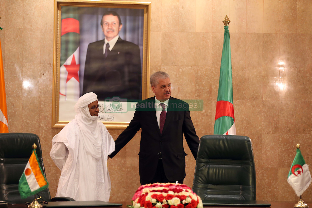 Algerian PM Abdelmalek Sellal and his Nigerien counterpart Brig Rafini sign contracts at the government palace in Algiers, Algeria, October 27, 2016. Photo by Billal Bensalem/APP/ABACARESS.COM