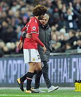 Football - 2017 / 2018 Premier League - Tottenham Hotspur vs. Manchester United<br /> <br /> Injured, Marouane Fellaini of Man Utd is consoled by Manager Jose Mourinho at Wembley Stadium.<br /> <br /> COLORSPORT/ANDREW COWIE