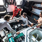 Leg 8 from Itajai to Newport, day 07 on board MAPFRE Xabi, Antonio, Joan and Guillermo trying to find the problem that switch off the electronics of the boat. 28 April, 2018.