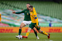 DUBLIN, REPUBLIC OF IRELAND - Sunday, October 11, 2020: Wales' captain Aaron Ramsey (R) and Republic of Ireland's Conor Hourihane during the UEFA Nations League Group Stage League B Group 4 match between Republic of Ireland and Wales at the Aviva Stadium. The game ended in a 0-0 draw. (Pic by David Rawcliffe/Propaganda)