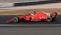 Ferrari's Sebastian Vettell during the 2018 British Grand Prix at Silverstone Circuit, Towcester.