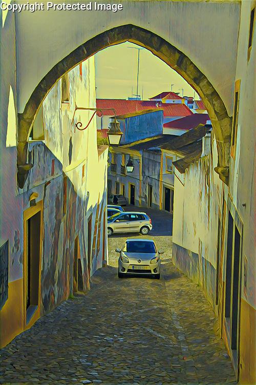 Car ascending a narrow backstreet in Evora, Portugal Portugal