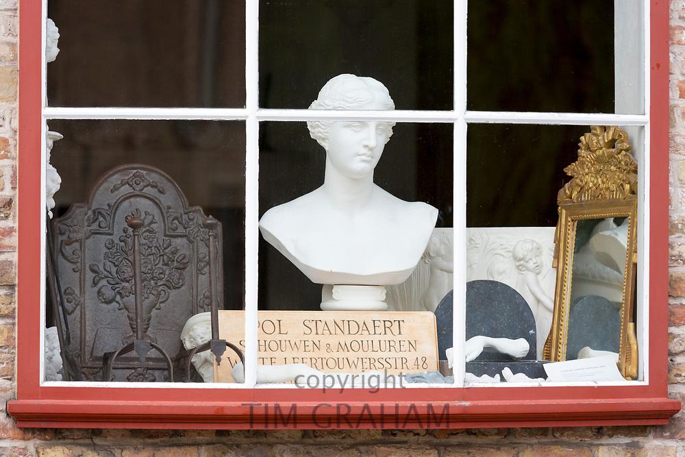 Traditional antique shop window in Rozenhoedkaai in old town Bruges - Brugge - Belgium