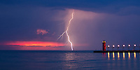 """Mere minutes after watching a partial solar eclipse set on Lake Michigan on May 20,2012,  This awesome lightning storm gave me several opportunities to catch lightning strikes over South Beach pier, in South Haven Michigan.  This image is natively a 10x20"""" panoramic print and is recommended for metallic paper."""