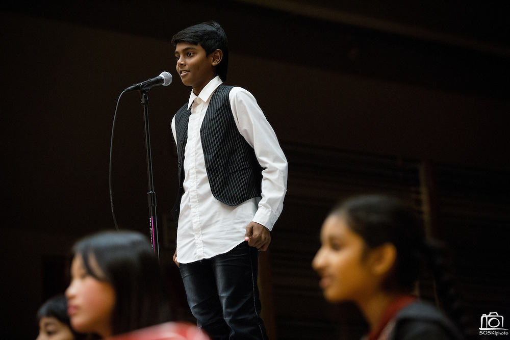 Eight grader Dinesh Balasubramanian spells a word during the 1st Annual Spelling Bee at Rancho Middle School in Milpitas, California, on December 9, 2015. (Stan Olszewski/SOSKIphoto)