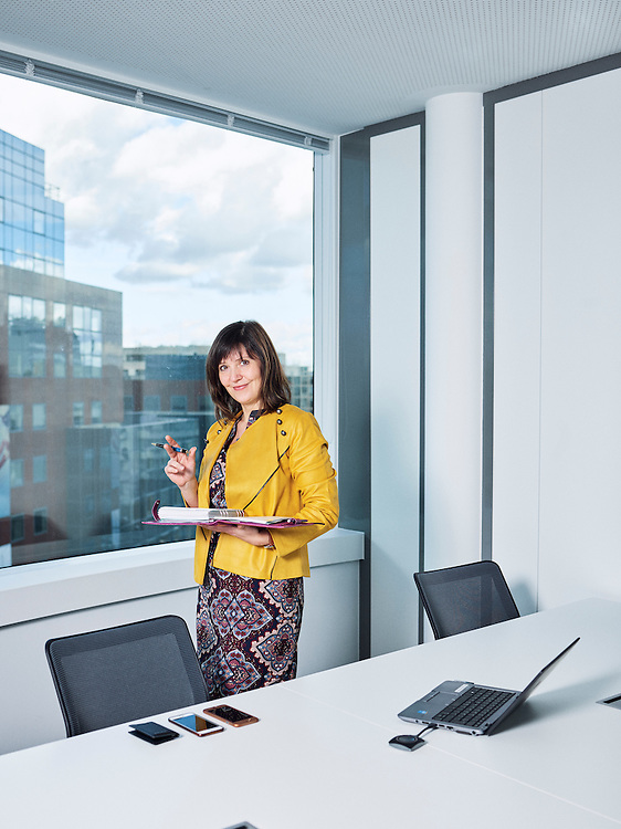 Levallois-Perret, France. February 28, 2017. Agnieszka Jaros in her office for the day (she has to make a reservation whenever she gets to work; no one has a assigned office). She's a Manager for Personal Finance Consulting at BNP Paribas Personal Finance. Photo: Antoine Doyen