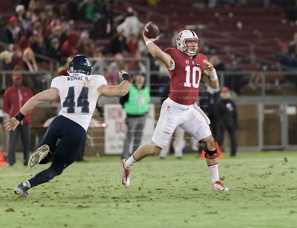 PALO ALTO, CA - NOVEMBER 26:  Keller Chryst #10 of the Stanford Cardinal attempts a pass in an NCAA football game against the Rice Owls played on November 26, 2016 at Stanford Stadium in Palo Alto, California.  Rushing Chryst is Brian Womac #44 of Rice.  (Photo by David Madison/Getty Images)