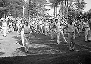 Male gymnasts perform outside, Gymnastics show in the 25th anniversary celebrations of Janakkala Cooperative Store, Finland,  1933