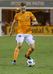 August 4, 2018 - Houston, TX, U.S. - HOUSTON, TX - AUGUST 04:  Houston Dynamo defender Adam Lundqvist (14) dribbles the ball during the soccer match between Sporting Kansas City and Houston Dynamo on August 4, 2018 at BBVA Compass Stadium in Houston, Texas.  (Photo by Leslie Plaza Johnson/Icon Sportswire) (Credit Image: © Leslie Plaza Johnson/Icon SMI via ZUMA Press)