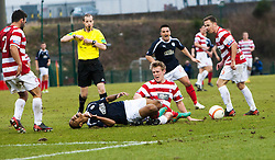 Hamilton's Jonathan Page gets a red card from Referee William Collum after this tackle on Falkirk's Lyle Taylor.<br /> Hamilton 1 v 2 Falkirk, Scottish Cup quarter-final, Saturday, 2nd March 2013.<br /> ©Michael Schofield.