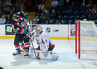 KELOWNA, CANADA - OCTOBER 16: Corbin Boes #1 of the Lethbridge Hurricanes defends the net against Rourke Chartier #14 of the Kelowna Rockets on October 16, 2013 at Prospera Place in Kelowna, British Columbia, Canada.   (Photo by Marissa Baecker/Shoot the Breeze)  ***  Local Caption  ***