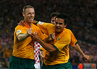 Photo: Glyn Thomas.<br />Croatia v Australia. Group F, FIFA World Cup 2006. 22/06/2006.<br /> Australia's Craig Moore (L) celebrates with Tim Cahill (R) after equalising from the penalty spot.