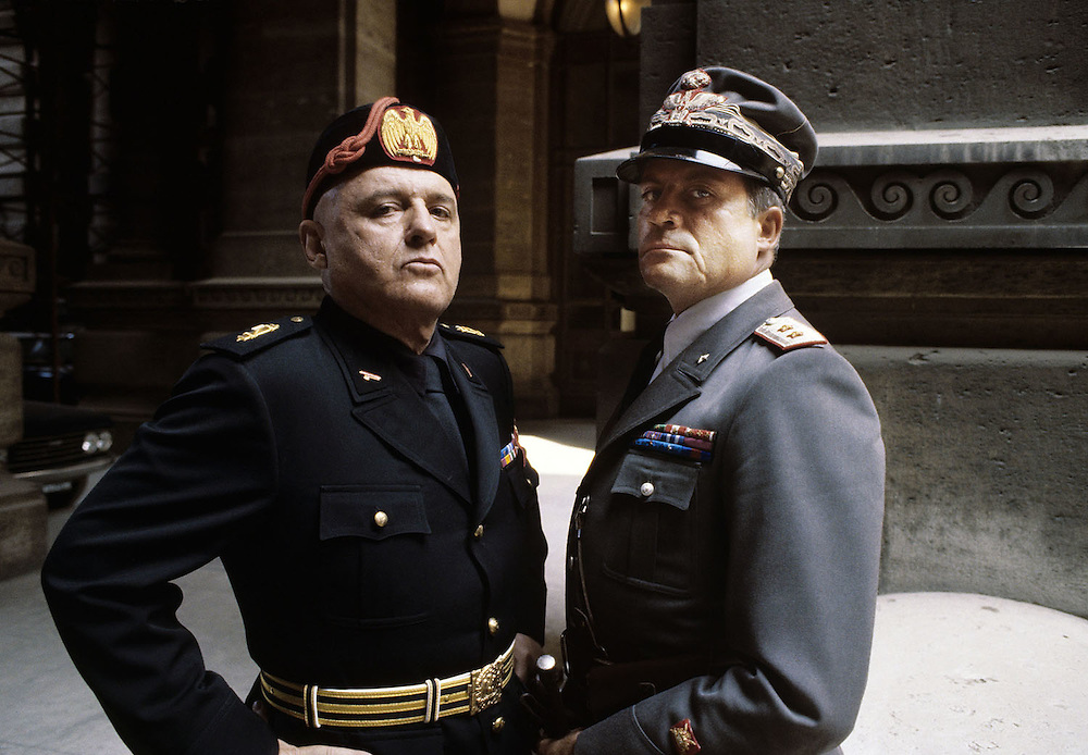 American actor Rod Steiger plays the part of Benito Mussolini and British actor Oliver Reed plays the part of General Rodolfo Graziani in the film 'Lion of the Desert' about Omar Mukhtar. 1979. Photograph by Terry Fincher