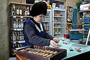 Sikachi-Alyan, Russia, 29/02/2004.&#xD;Shopkeeper in the only store in this remote village.<br />