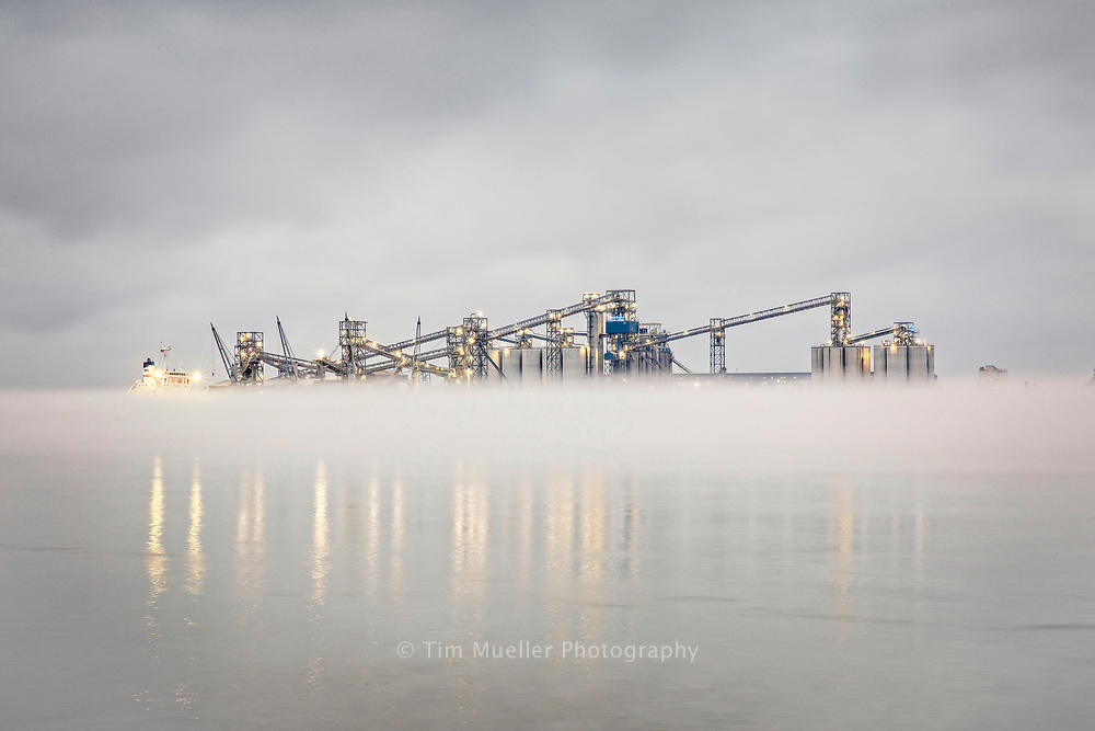Fog floats above the Mississippi River at the I-10 bridge and the Port of Greater Baton Rouge.