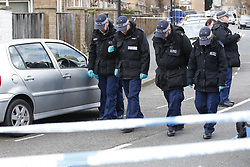 © Licensed to London News Pictures. 26/03/2018. London, UK. Police conduct a fingertip search in the road where a man was shot in Hackney. A murder investigation has been launched after a 26-year-old man was discovered in the street suffering from gunshot wounds on Sunday night. Despite the best efforts of paramedics, he was pronounced dead at the scene. Photo credit: Peter Macdiarmid/LNP